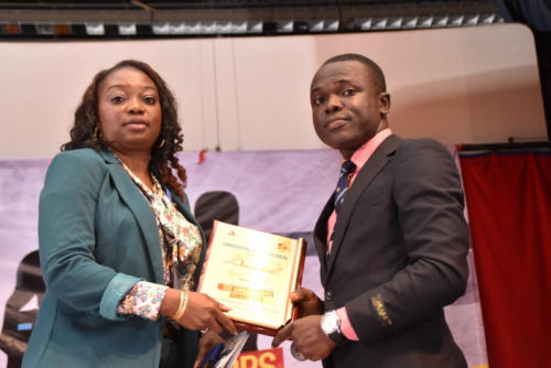 CEO Rave Television, Agatha, receives her award