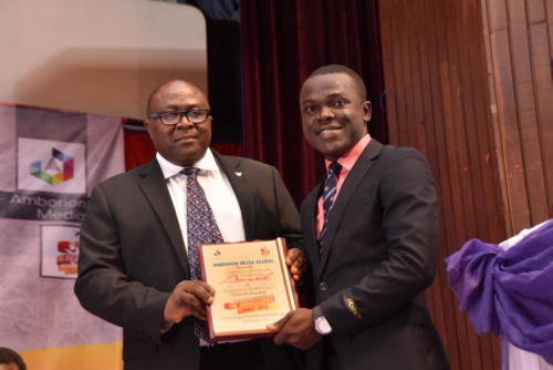 Mr Ayileka receives award on behalf of his Group MD, at Summit 2.0