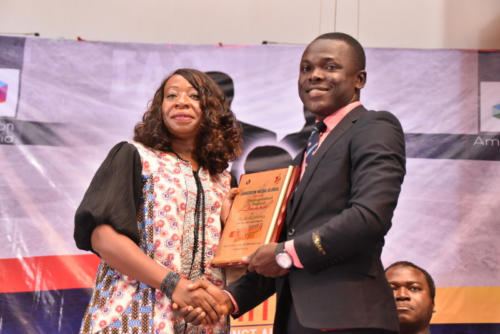Mrs Doris Akpovwa eceives her award at TAS.2.0