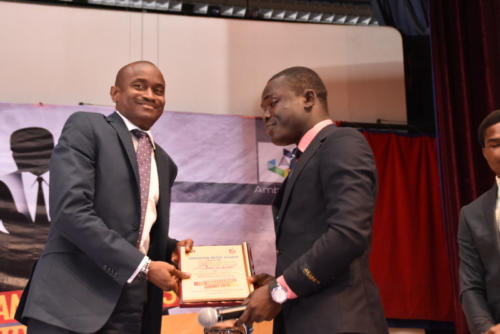 Oluwakayode Adigun receives his award at TAS 2.0