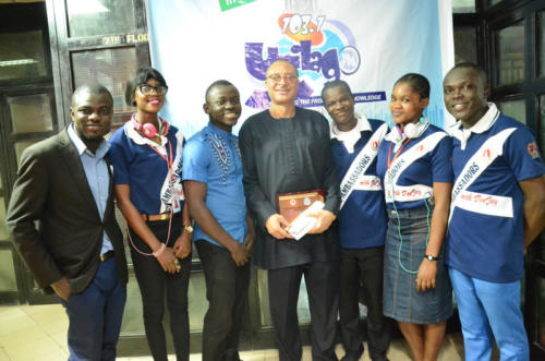 Prof Pat Utomi flanked by thr radio crew members
