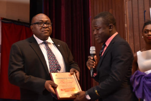 Receiving award on behalf of WEMA Bank Group MD.